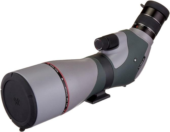 A picture containing object, telescope, white, black  Description automatically generated