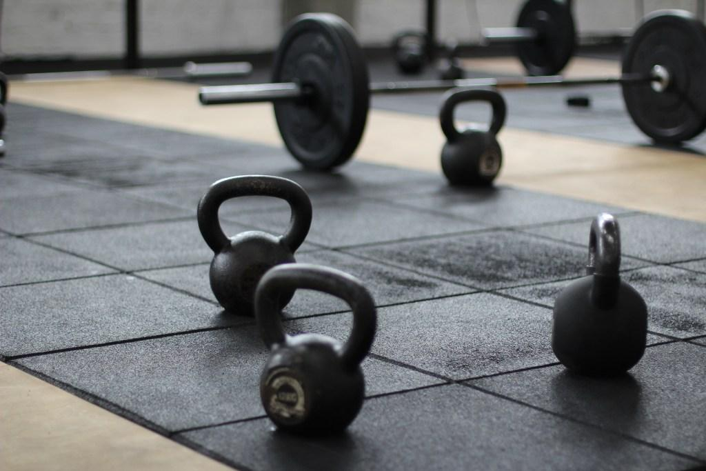Weights on a floor  Description automatically generated with low confidence