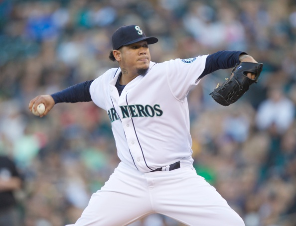 SEATTLE, WA - SEPTEMBER 13: Seattle Mariners starter Felix Hernandez #34 delivers a pitch in the first inning of a baseball game against the Oakland Athletics at Safeco Field on September 13, 2014 in Seattle, WA. (Photo by Stephen Brashear/Getty Images)