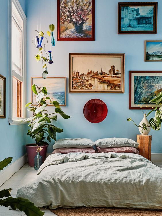 Vintage Bedroom Full of Plants and Retro Paintings