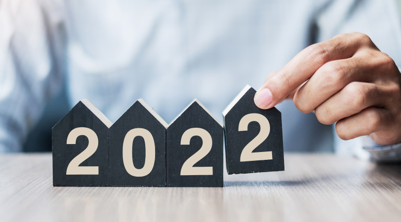 """House shaped wooden blocks showing """"2022"""""""