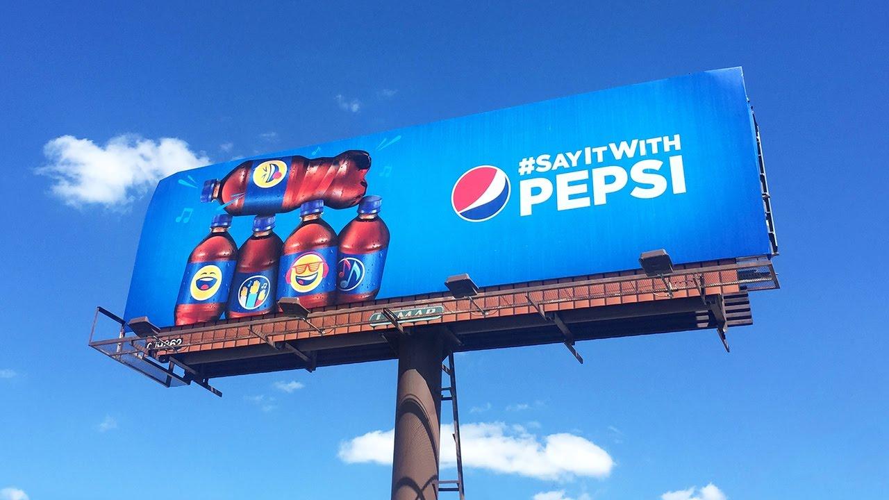 "A Pepsi billboard ad saying ""#SayItWith Pepsi""."
