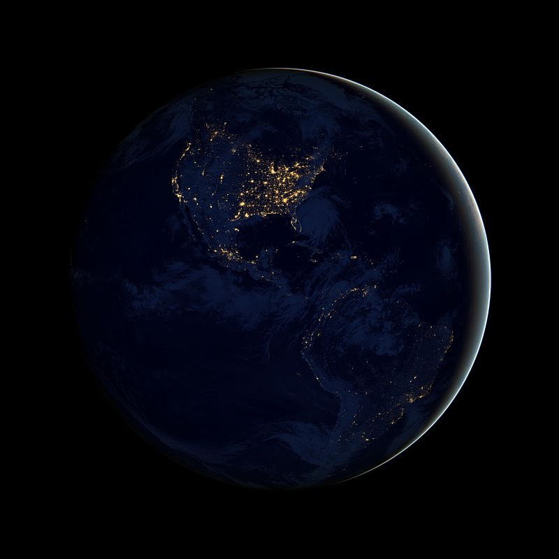 Image of the Earth as seen from space. North America is well-lit compared to South America. It illustrates a difficulty of applying machine learning to satellite imagery--not all places are equally visible.