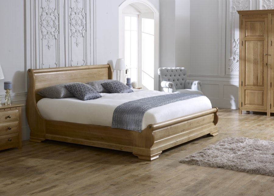 The Parisienne Sleigh Bed in Natural Oak