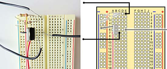 Top part of a breadboard with wires, transistor, and resistors.