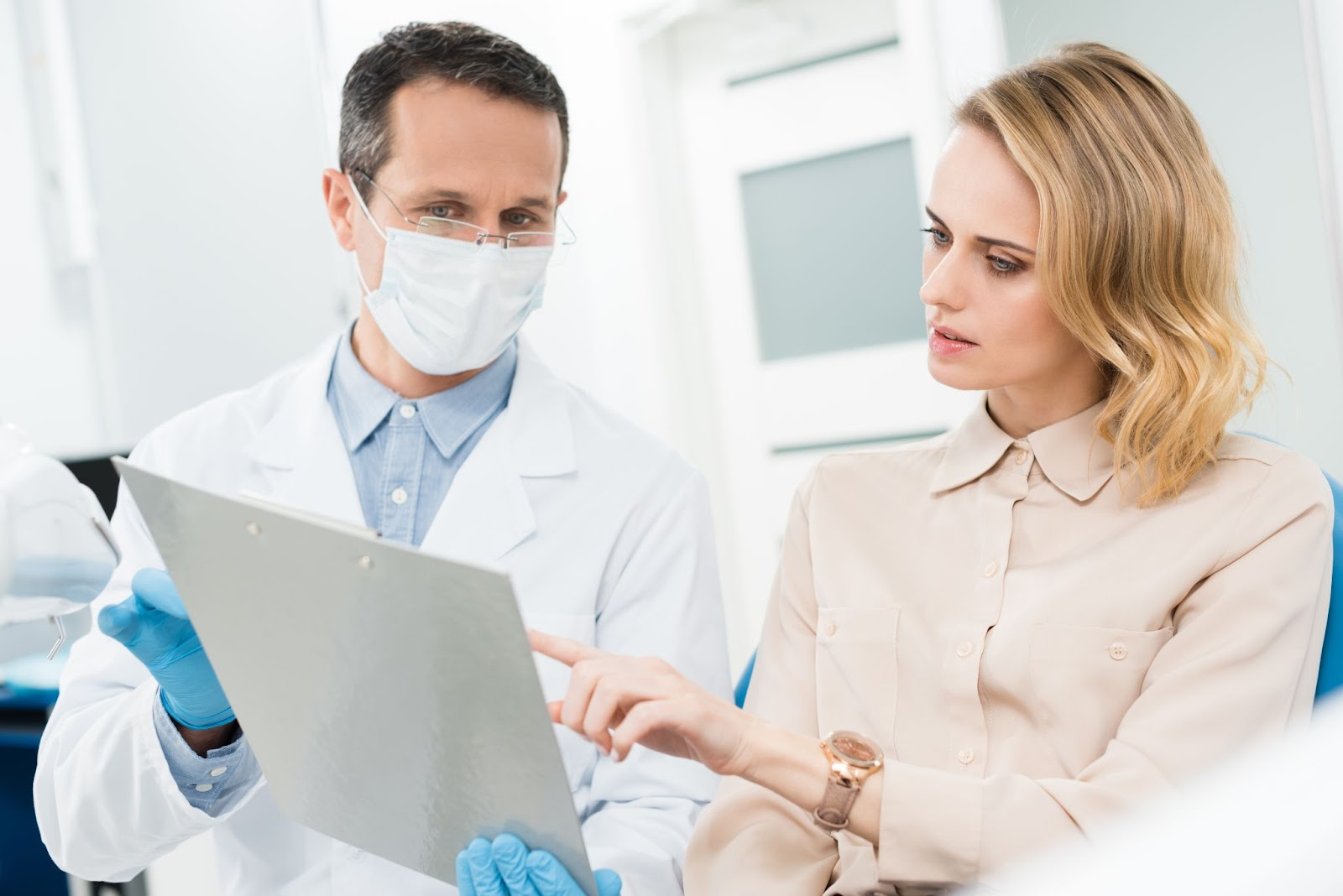dentist reviewing a patient's chart with her