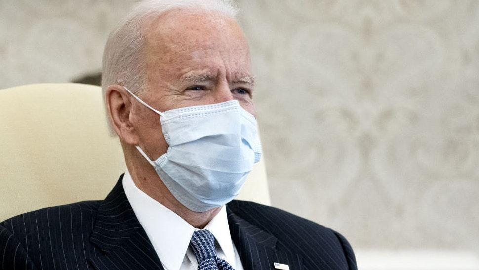 U.S. President Joe Biden wears a protective mask while meeting with Democratic senators in the Oval Office of the White House in Washington, D.C., U.S., on Wednesday, Feb. 3, 2021. The Senate on Tuesday began a process that would let Democrats pass Biden's $1.9 trillion stimulus without Republican votes.