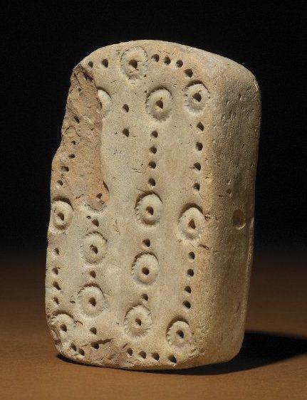 Угадайте, сколько лунок в этой месопотамской игре. Подсказка: она изначально называлась «58 лунок». Фото: Кэмерон Браун