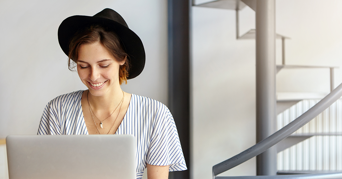 women in black hat browsing the internet