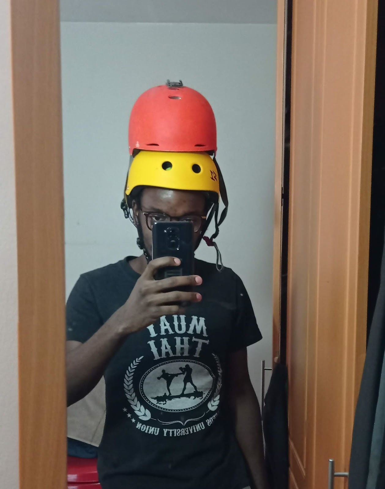 riding wearing two helmets for safety
