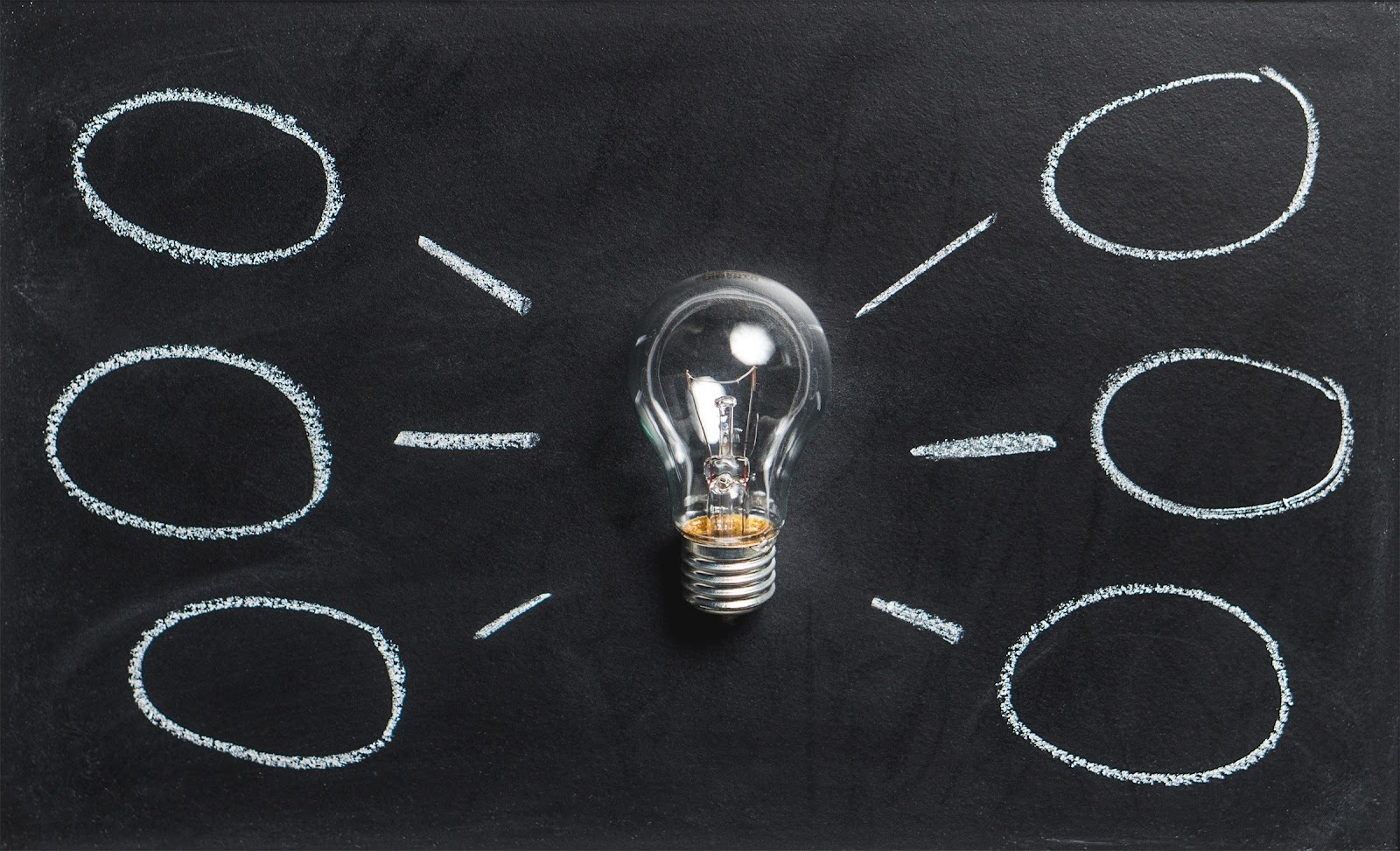 A light bulb surrounded by different ideas. There are a lot of ways you can learn how to speak a language.