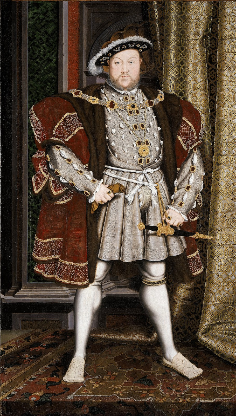 Portrait of Henry VIII in his robes of office looking very pleased with himself.