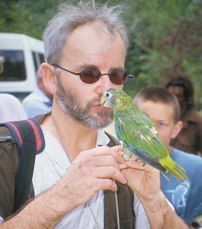 Dr. Jan Hooimeijer examines a confiscated Jamaican parrot that was headed for the black market