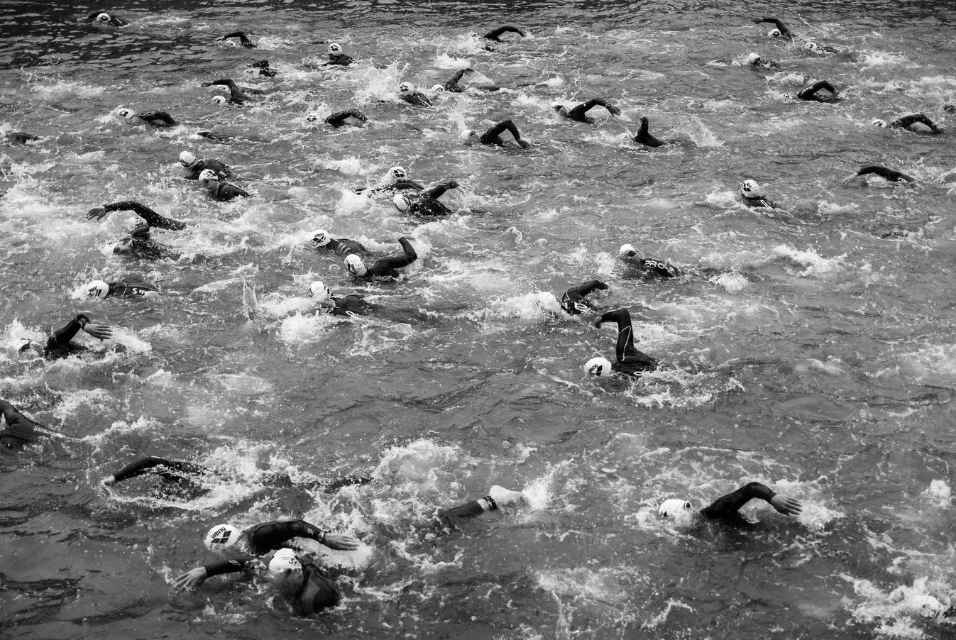 Triathlon swimmers in open water.