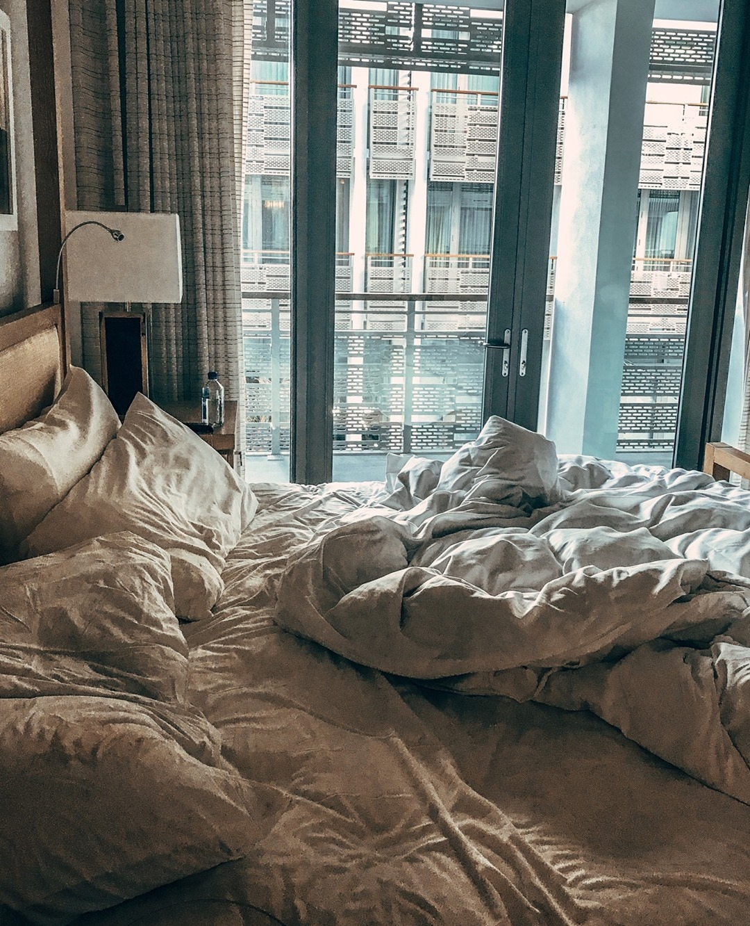 A undone bed in the morning