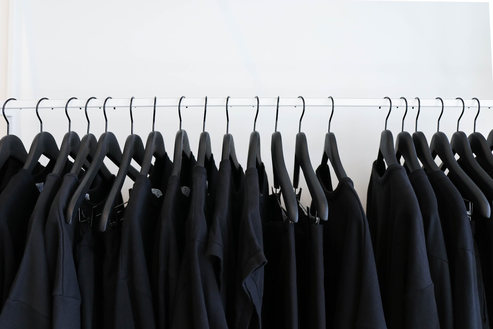 Black shirts hanging on a hanger
