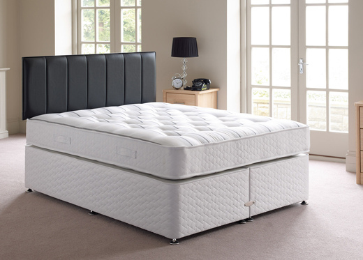 Brand new white bed with black headboard.