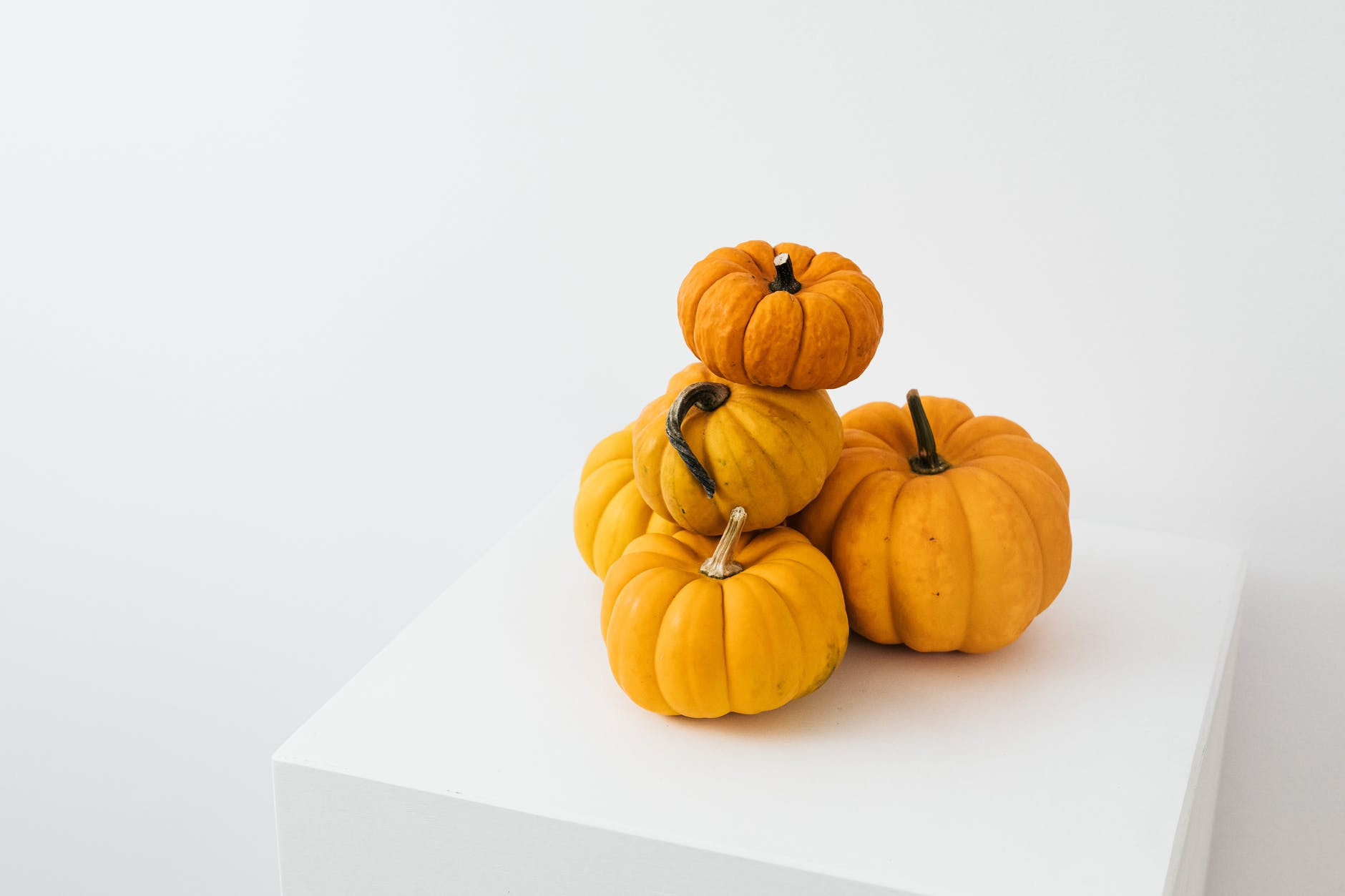 A group of pumpkins  Description automatically generated with low confidence