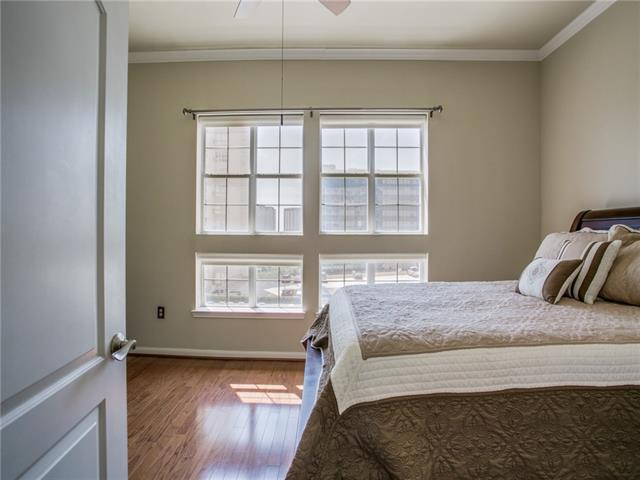 The master bedroom, featuring hardwood floors and natural light.