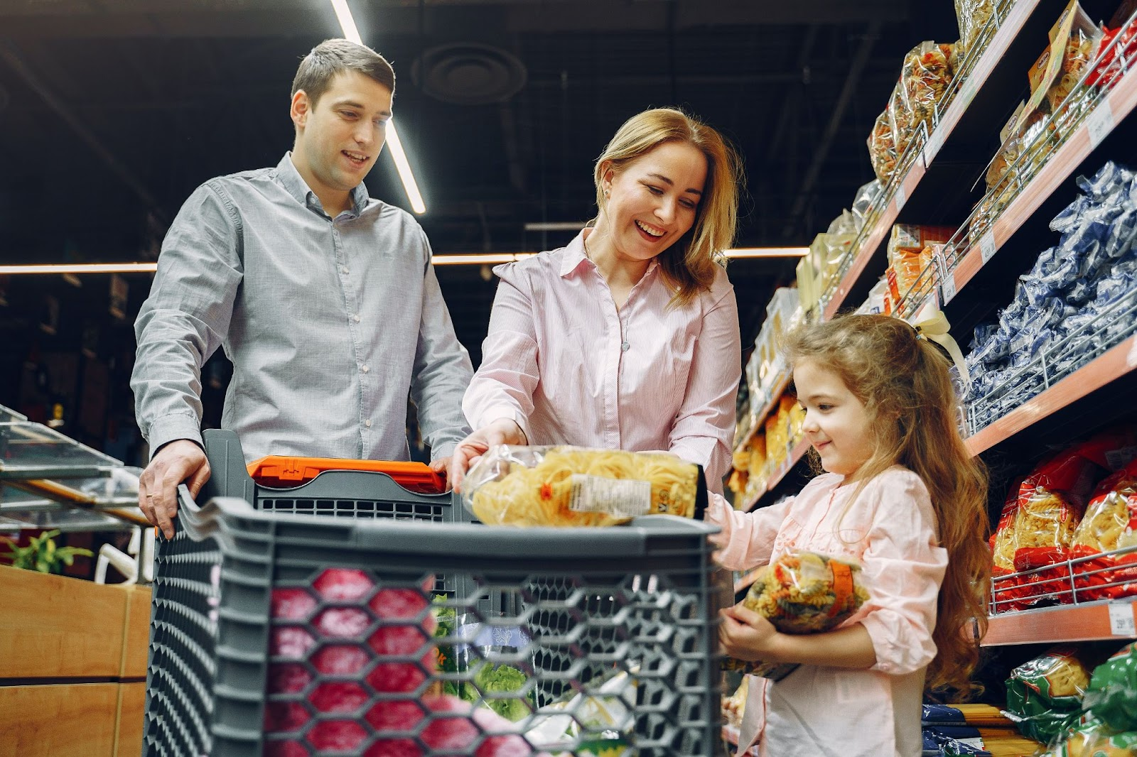 a child learns about financial values by helping grocery shopping