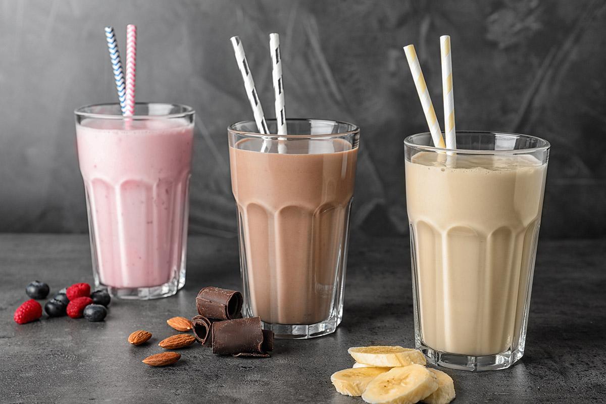Strawberry, chocolate, and vanilla organic whey protein smoothies