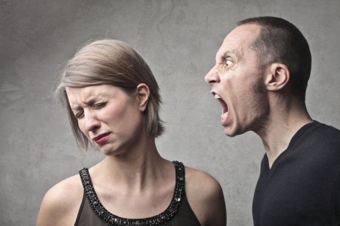 man shouting at woman