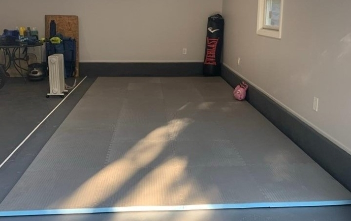 a garage gym with foam gym mats