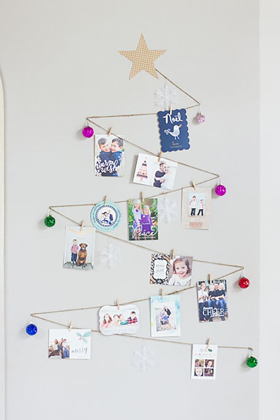 Twine Wall Tree Card Holder: These 25 DIY Christmas Card Holders - That Double As Festive Decor will allow you to beautifuly display your cards and will also give you some great decor.