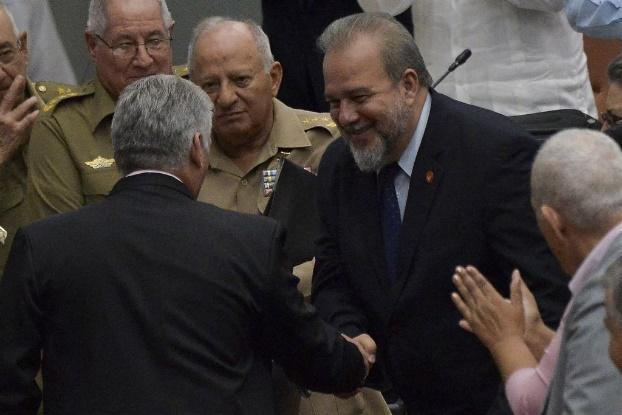 古巴觀光部長馬雷羅(右)21日成為古巴40多年來的首位總理。(法新社提供)