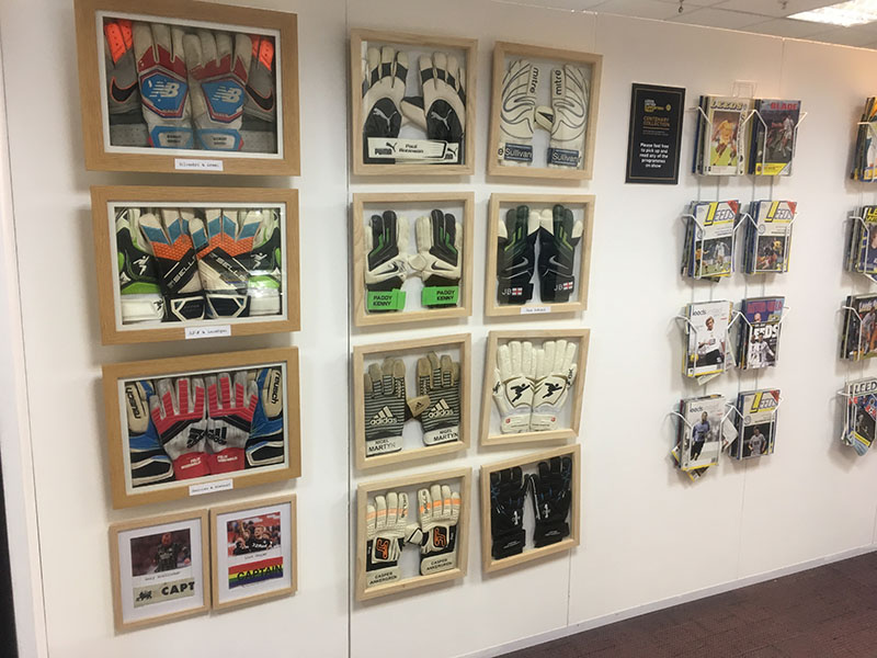 Framed football gloves and programmes