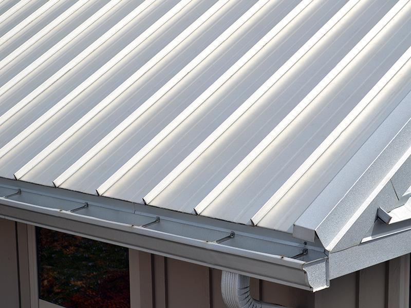 Close-up of a grey metal roof on a home