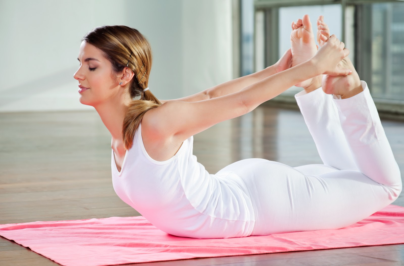 The Bow Pose improves posture and spinal flexibility.