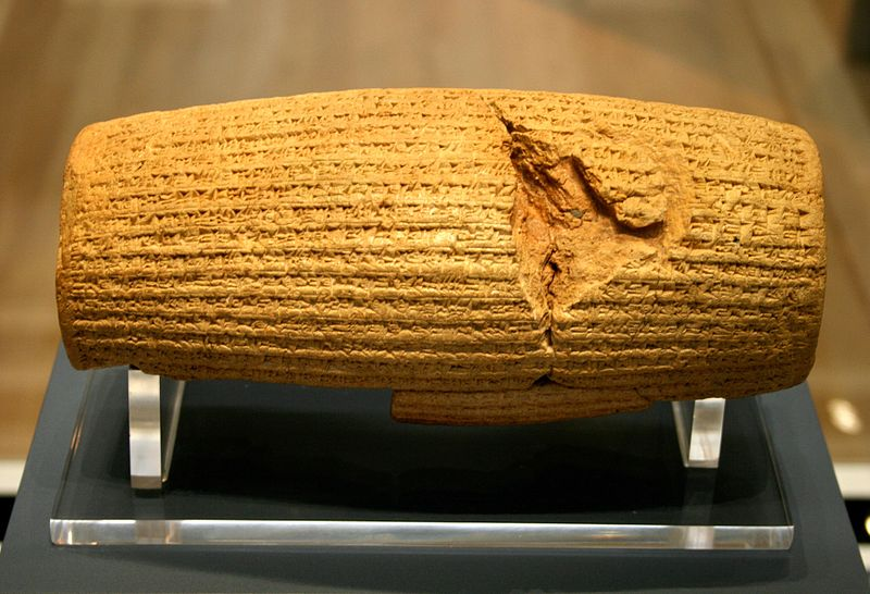 The Cyrus Cylinder: a rounded cylinder of stone with cuneiform script carved into it on all surfaces.
