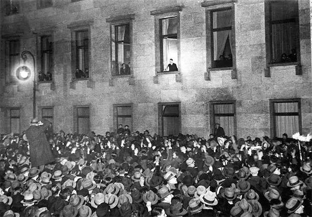 Hitler, at the window of the Reich Chancellery, receives an ovation on the evening of his inauguration as chancellor, 30 January 1933