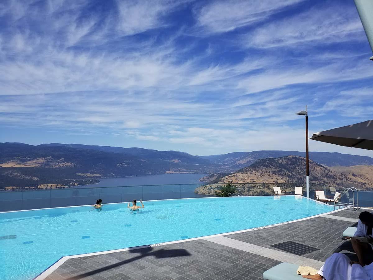 The swimming pool at Sparkling Hills Resort with views above Kalamalka Lake and the Okanagan Valley