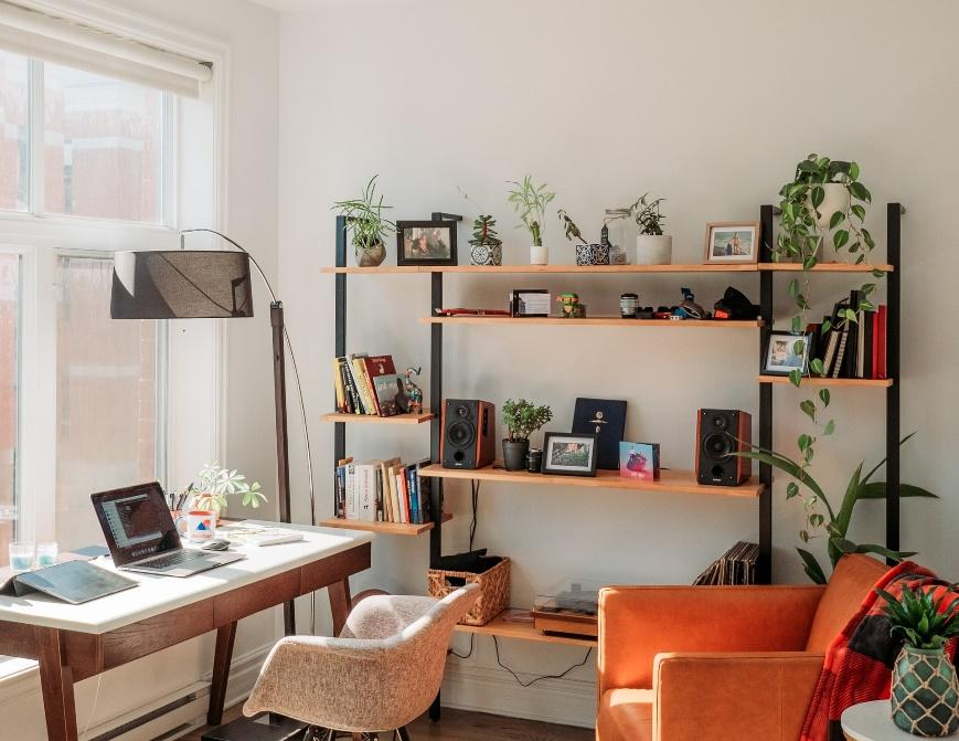 A home office corner by a window.
