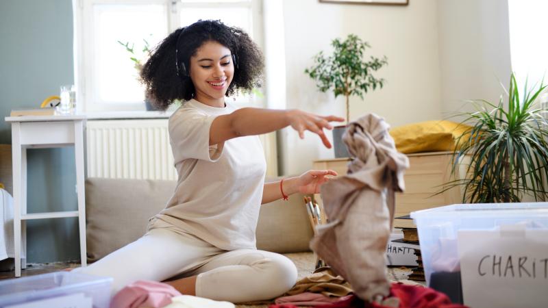 a woman decluttering her wardrobe
