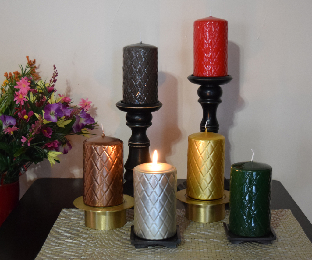 Over dipped pillar candles in assorted colors