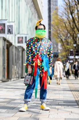 a person walking down a sidewalk
