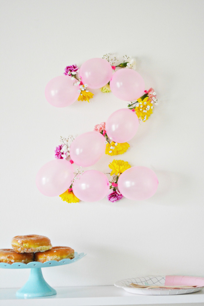 Tutorial to create balloon flower number DIY party backdrops perfect for a tea party
