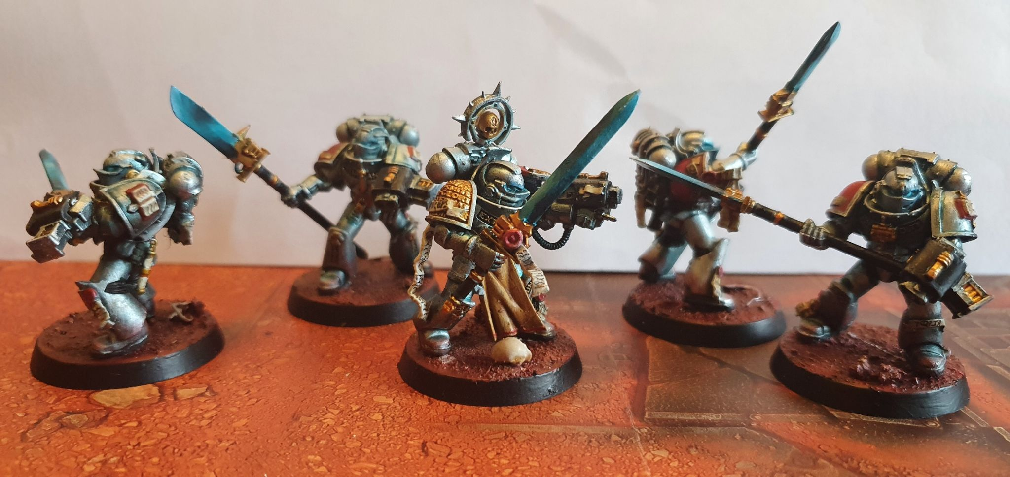 Silver to deep turquose armour, accented with gold.  The Force weapons are deep turquoise to bright blue.  They are on martian sand effect bases, some with light rocks and wire.