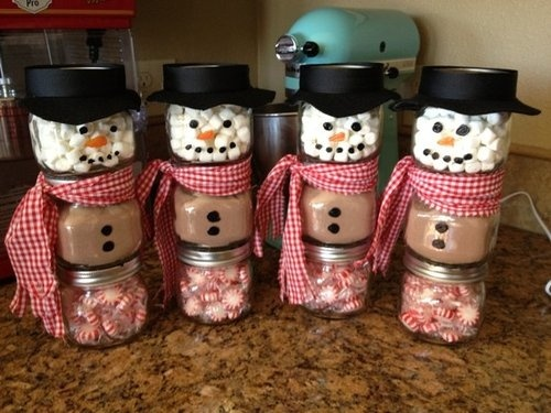 fill up three glass jars with your favourite candy or desserts and then stack them up and secure with adhesive - Nice Christmas Gifts