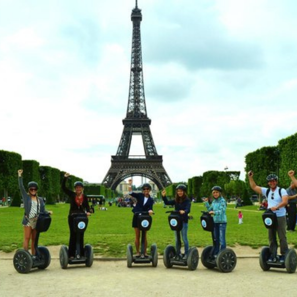 Tourists on a segway in front of the Eiffel Tower