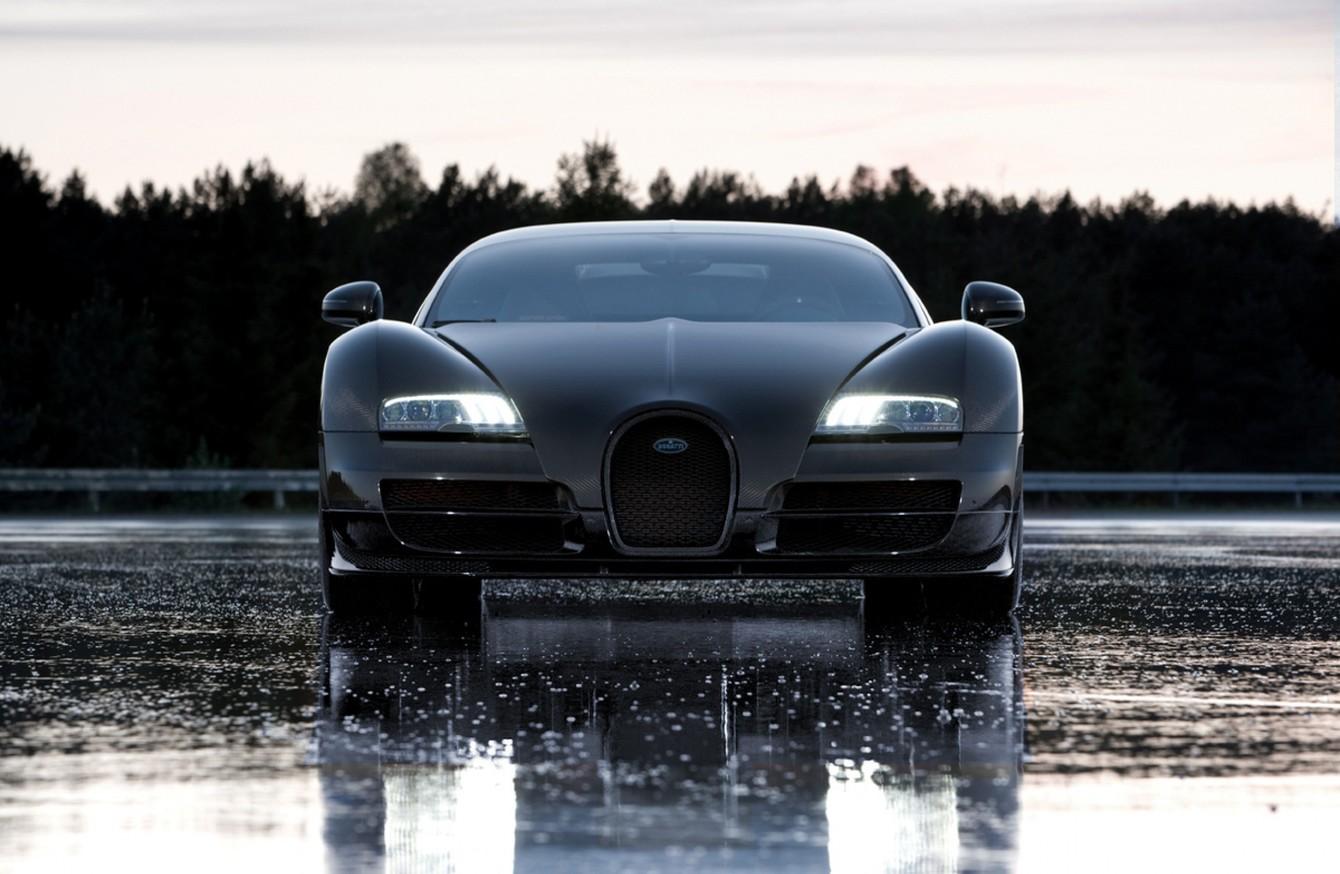 black car in the rain