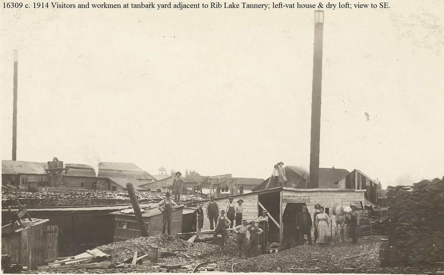 C:\Users\Robert P. Rusch\Desktop\II. RLHSoc\Documents & Photos-Scanned\Rib Lake History 16300-16399\16309 P. c. 1914 Rib Lake Tannery; right-tanbark; center-boiler house; left-vat house; view SW.jpg