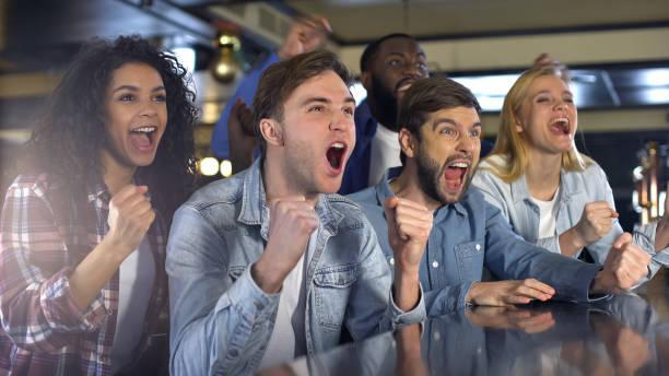 https://media.istockphoto.com/photos/group-of-fans-enjoying-sport-game-extremely-happy-about-win-relaxing-picture-id1158250621?k=20&m=1158250621&s=612x612&w=0&h=iFVxP3EHlp4yoFHRf7aPq5YxyMFIZ1AB67tRpkCHgNo=