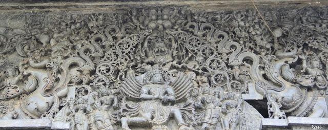 The Makar Torana. Notice Garuda and Narasimha in the centre, the ten circles in the leafy foliage and the flanking Makars on either side.
