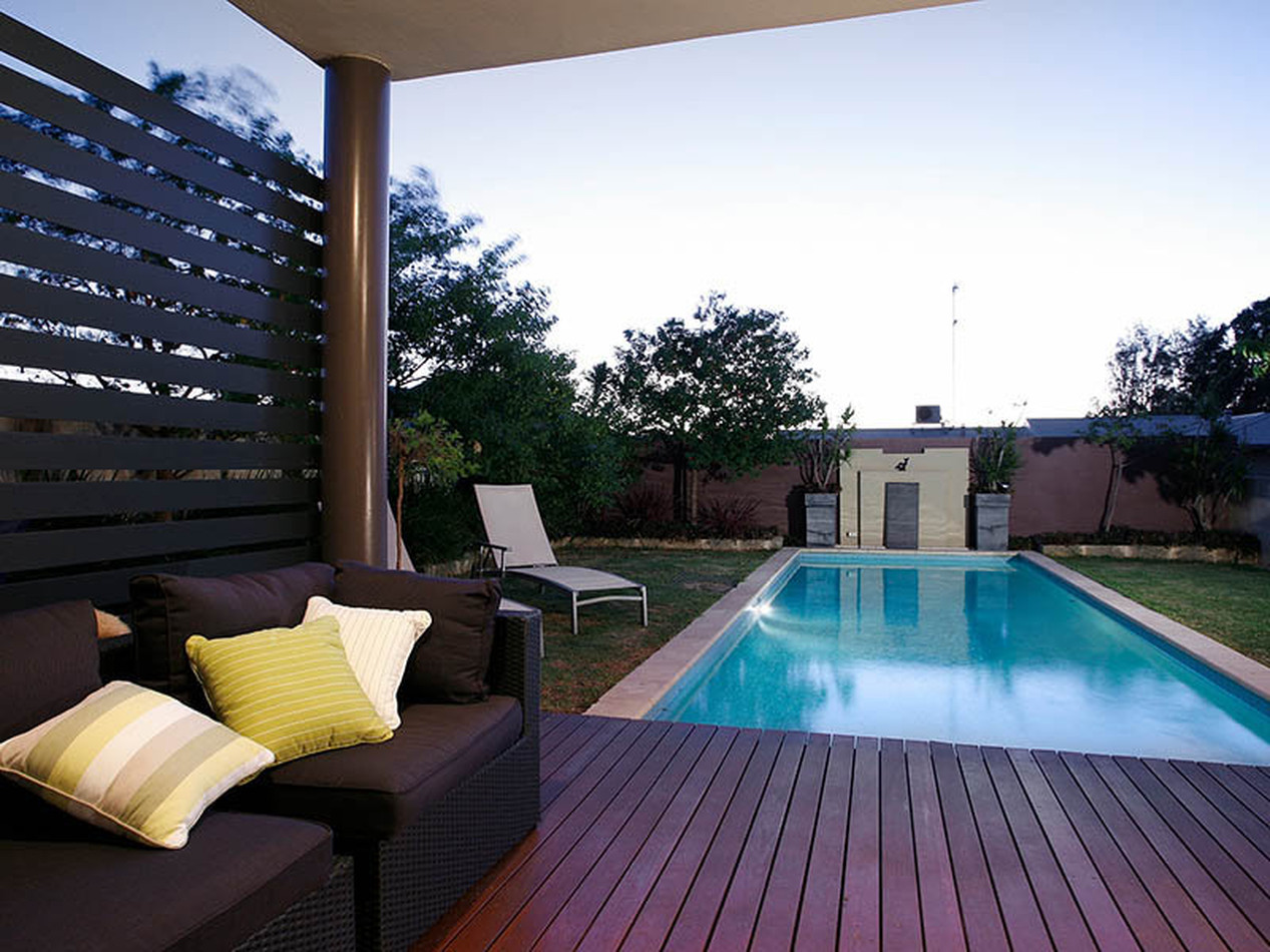 deck by blue water pools