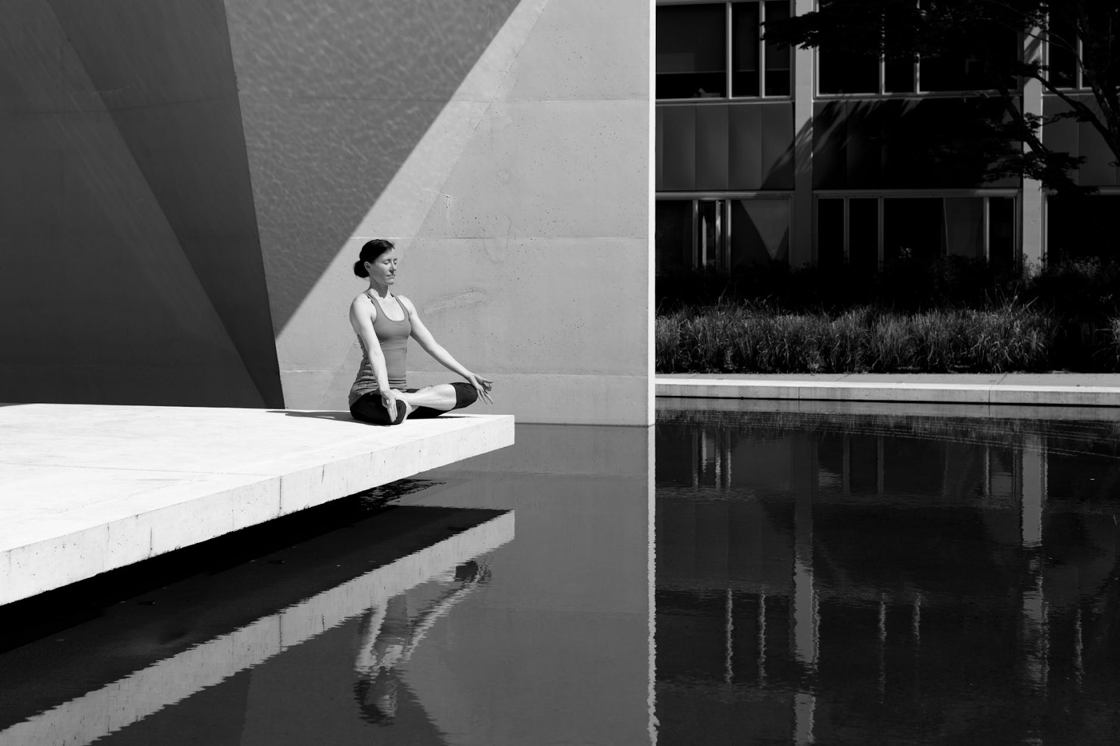 girl outside a building meditating