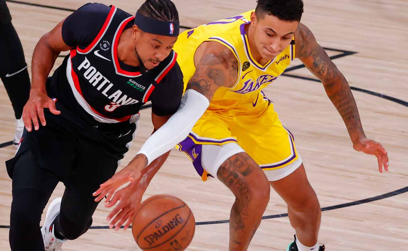 CJ McCollum of the Portland Trail Blazers steals the ball from Kyle Kuzma of the Los Angeles Lakers.